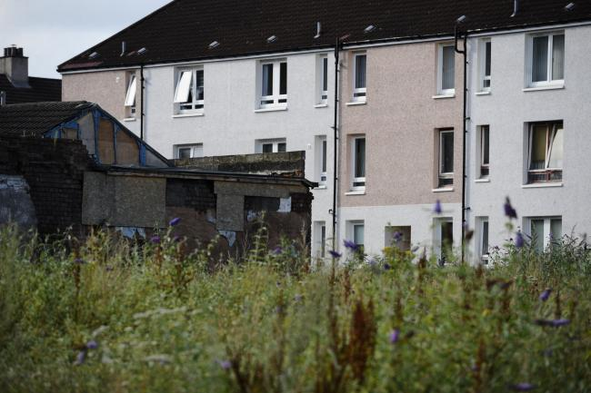 GLASGOW, SCOTLAND - August 01: housing is seen overlooking waste land in the Calton area of Glasgow's East End on August 01, 2019 in Glasgow, Scotland. Figures were released today named the city as one of the poorest in the UK (Photo by Jamie Simpson/