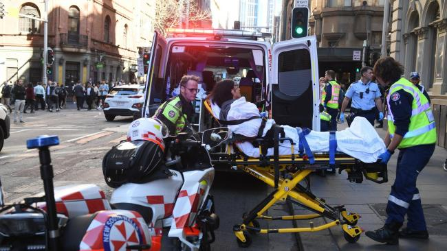 Woman in hospital after man 'tries to stab several people' in Sydney