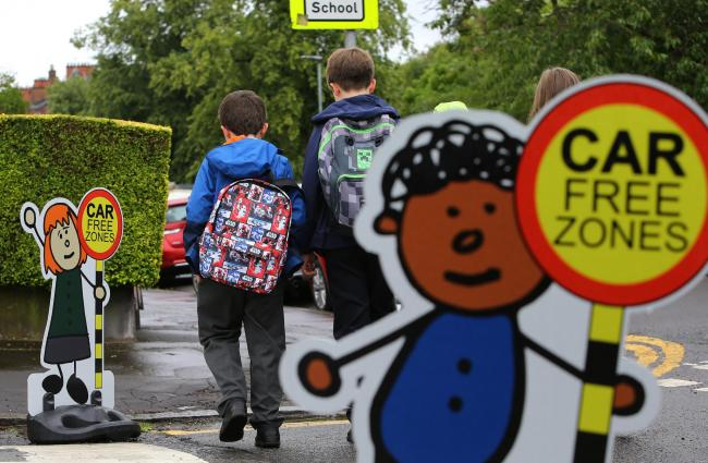 First day of the School Car Free Zone that is being trialled at six Glasgow schools. Pictured are children walking home from school on Elmwood avenue at Broomhill primary school...  Photograph by Colin Mearns.14 August 2019..