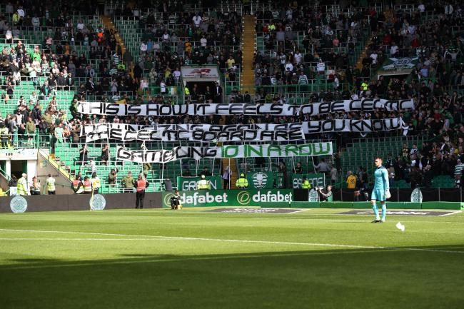 The Celtic fans make their feelings known towards the club's board prior to the narrow win over Dunfermline.
