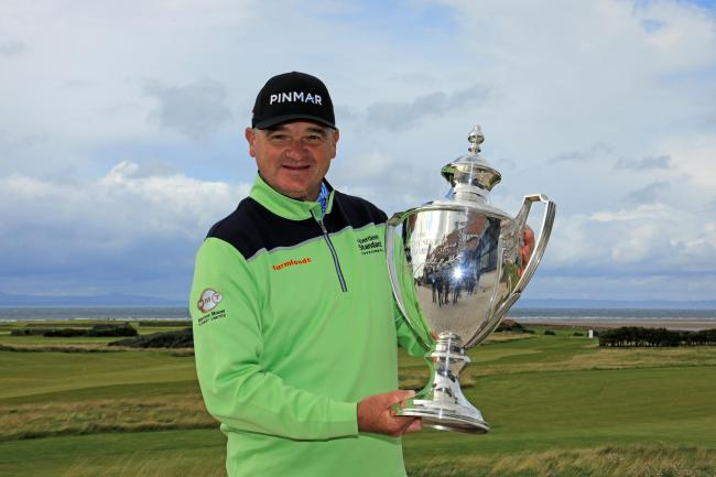 Paul Lawrie poses with the Scottish Senior Open trophy at Craigielaw