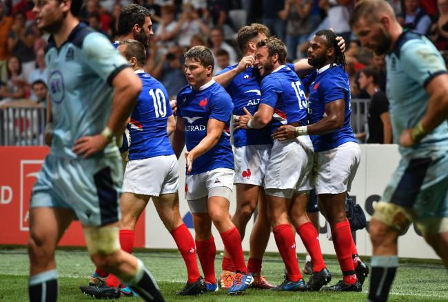 France's full back Maxime Medard (C) celebrates with teammates after scoring a try during the 2019 Rugby World Cup warm-up test match between France and Scotland, at the Allianz Riviera stadium, in Nice, on August 17, 2019. (Photo by Pascal GUYOT / AF