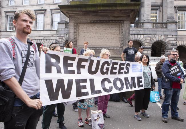 ***No Fee *** Scottish Refugee Council Protest today at the Court of Session in Edinburgh.Supporters gathered today in solidarity with refugees facing eviction in Glasgow.The court is currently hearing an appeal against its initial ruling that lock change