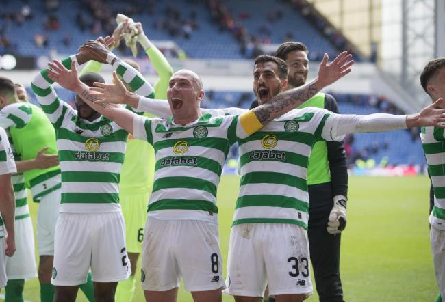 Scott Brown laps up the celebrations after Celtic beat Rangers at Ibrox.