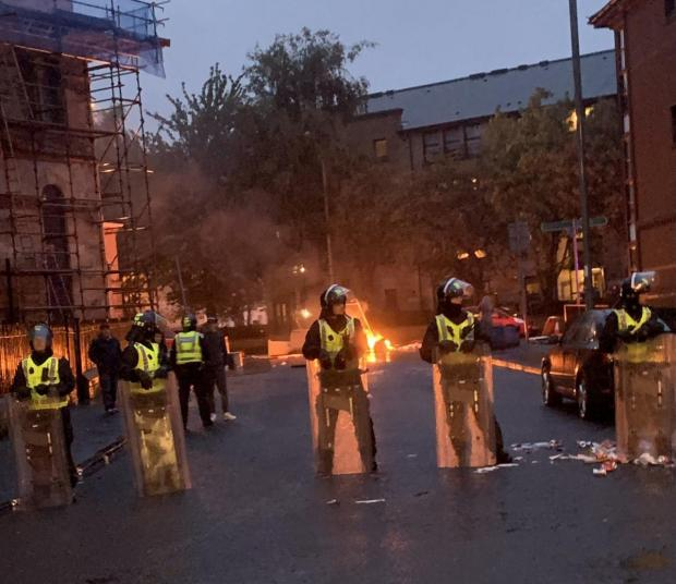Glasgow Times: Riot police in Govan last Friday night