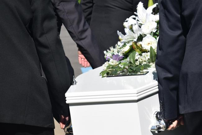 Coffin being carried at a funeral. .Stock image from Pixabay.com.