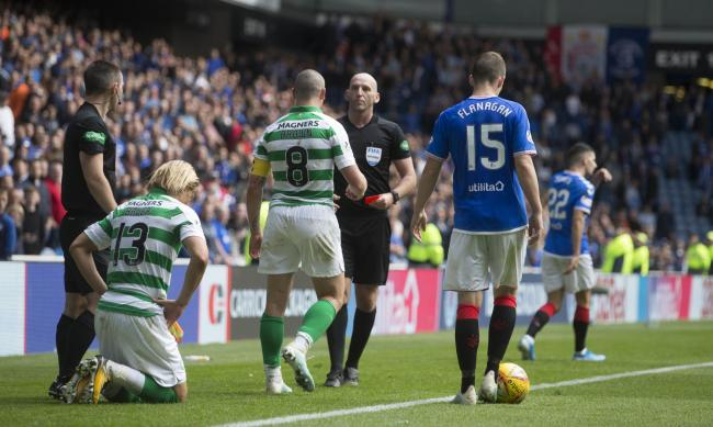 Rangers winger Jordan Jones, back right, after being sent off by referee Bobby Madden, centre, during the Ladbrokes Premiership match at Ibrox earlier this month for a foul on Celtic right back Moritz Bauer, left. Picture: Jeff Holmes/PA Wire.