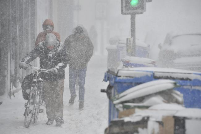 GLASGOW, SCOTLAND - FEBRUARY 28: a cyclist walks his bike down Gibson Street during heavy snowfall on February 28, 2018 in Glasgow, Scotland. (Photo by Jamie Simpson/Herald & Times) - JS.