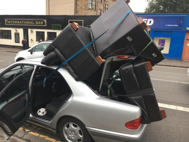 Traffic cops stunned after discovery car with sofa chairs attached on Aikenhead Road