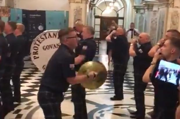 Govan loyalist flute band at centre of Belfast City Council probe following footage of them playing in City Hall
