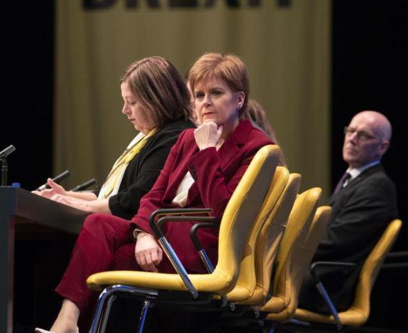 First Minister Nicola Sturgeon listens to Westminster leader Ian Blackford MP deliver his address at the opening of the 2019 SNP autumn conference at The Event Complex Aberdeen (TECA).
