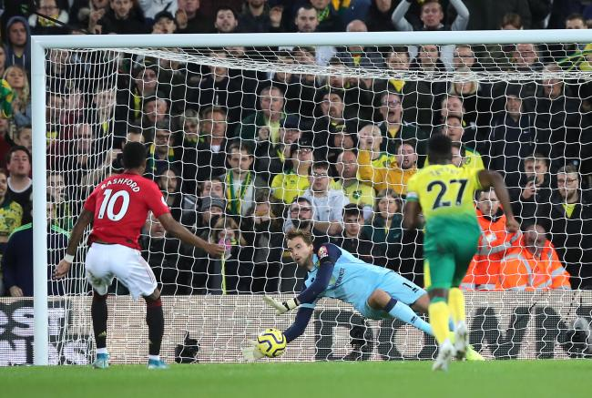 NORWICH, ENGLAND - OCTOBER 27: Tim Krul of Norwich City saves a penalty from Marcus Rashford of Manchester United during the Premier League match between Norwich City and Manchester United at Carrow Road on October 27, 2019 in Norwich, United Kingdom. (Ph