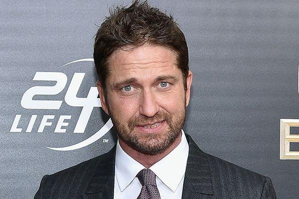 'Dish of the day': Hollywood superstar Gerard Butler poses with staff in coffee shop in Bearsden