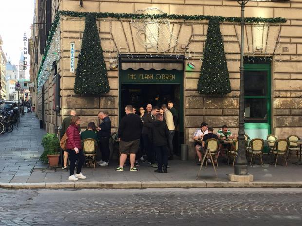 Celtic fans enjoying a drink in this Irish bar were disturbed by mask-wearing Lazio hooligans, who stabbed two visiting supporters.