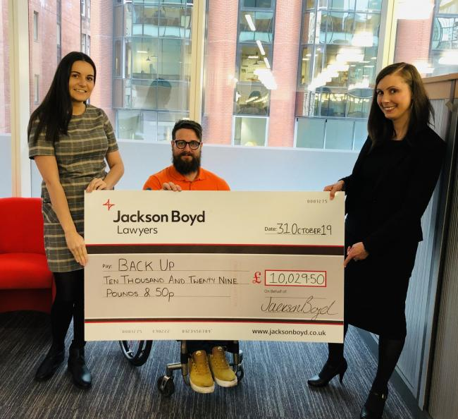 Jackson Boyd staff present Back Up with £10,000 cheque following company fundraiser