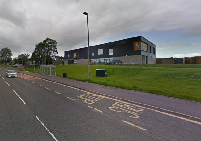 Road near Glasgow primary school closed after woman struck by car