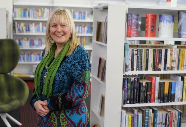 Karen Gallacher at Cardonald library, taking part in a creative writing class. Photograph: Colin Mearns