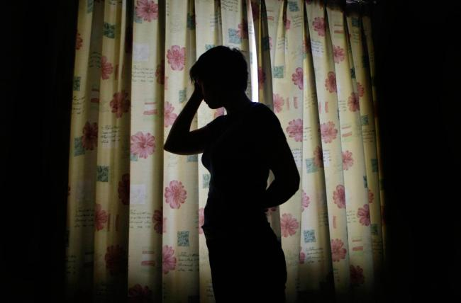 NOTE: PICTURE POSED BY MODEL.  A silhouette of a child is seen, as a disturbing report revealed that children are among hundreds of young women being trafficked into Ireland to be sold into the sex trade..