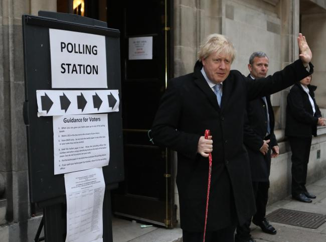Prime Minister Boris Johnson leaves the polling station with his dog Dilyn after casting his vote in the 2019 General Election at Methodist Central Hall, London. PA Photo. Picture date: Thursday December 12, 2019. See PA story POLITICS Election. Photo cre