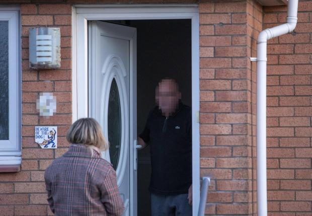 Glasgow Times: Evening Times reporter speaks to a man on the doorstep of a house in Baillieston. Re. catfishing story about Danielle Paita...14 November 2019..