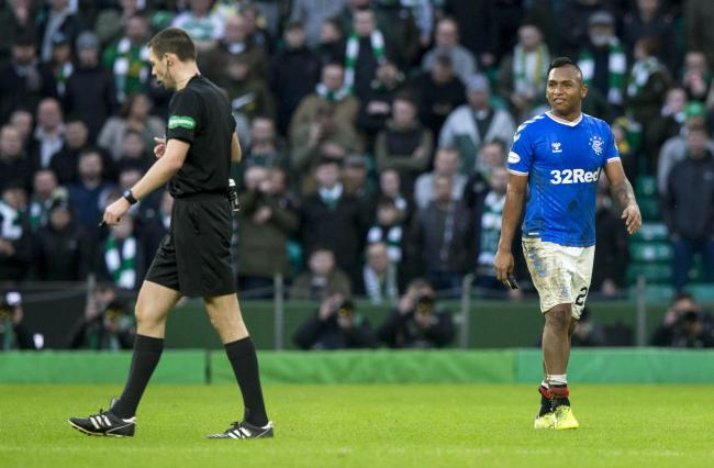 Rangers striker Alfredo Morelos, right, after being sent off by Kevin Clancy, left, at Parkhead last month. Picture: Jeff Holmes/PA Wire.