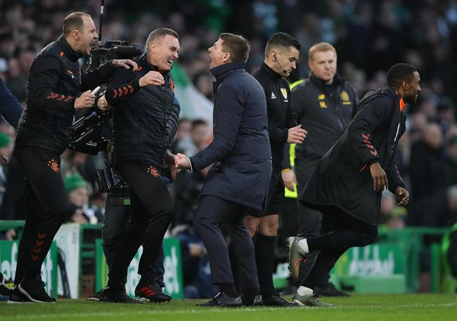 Steven Gerrard celebrates with backroom staff at full time after defeating Celtic