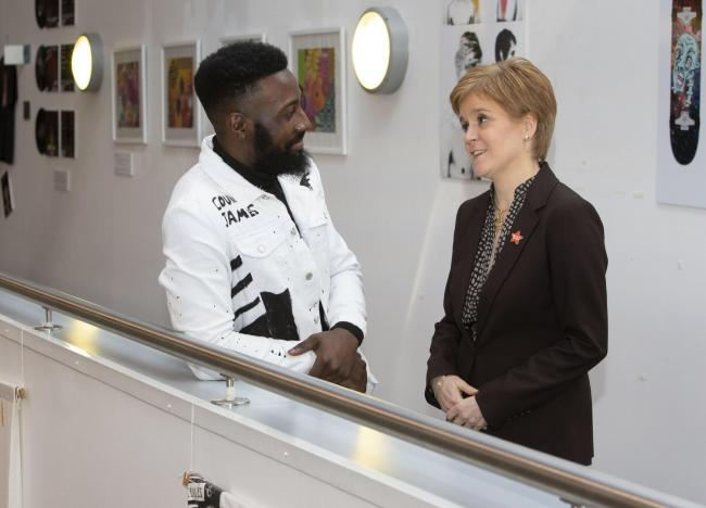 Courage, who sang on the day, with First Minister Nicola Sturgeon.
