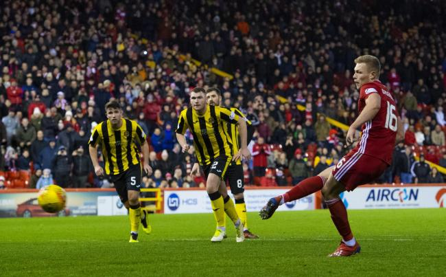 ABERDEEN, SCOTLAND - JANUARY 18: Aberdeen's Sam Cosgrove makes it 1-0 from the penalty spot during the William Hill Scottish Cup 4th round tie between Aberdeen and Dumbarton at Pittodrie on January 18, 2020 in Glasgow, Scotland. (Photo by Bill