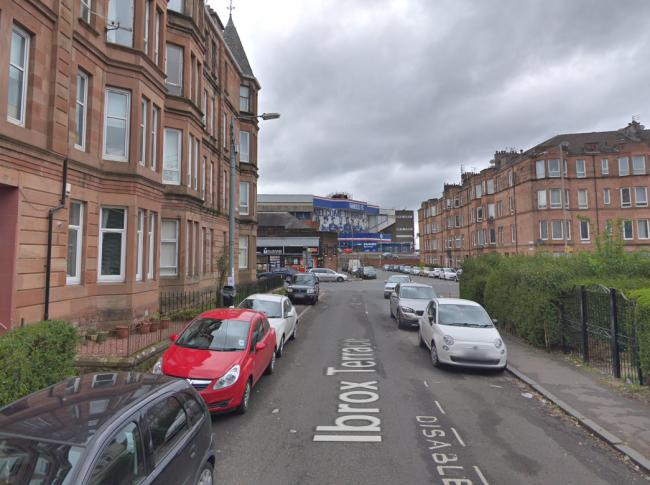 The woman was robbed at her home on Ibrox Terrace