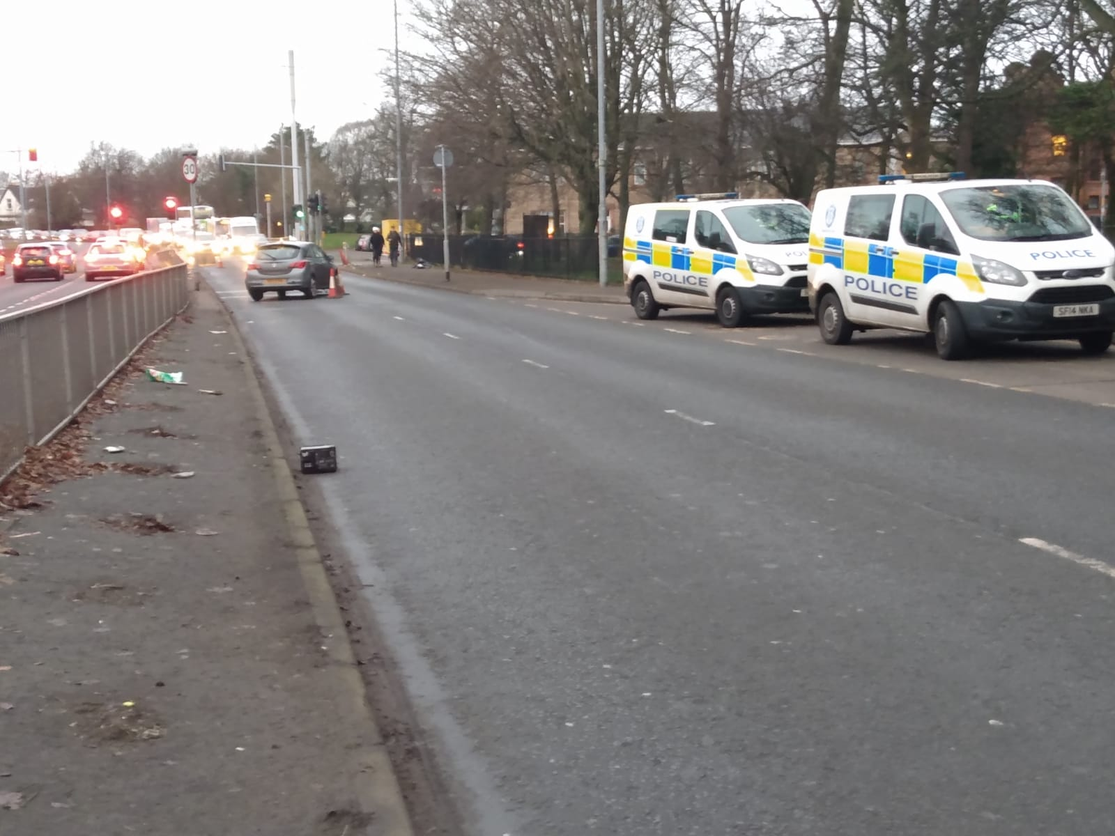 Glasgow crash leaves car facing wrong way as police partially shut busy street