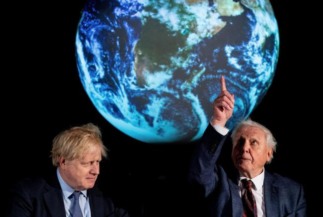 The Prime Minister Boris Johnson (left) and Sir David Attenborough at the launch of the next COP26 UN Climate Summit at the Science Museum, London. PA Photo. Picture date: Tuesday February 4, 2020. Photo credit should read: Chris J Ratcliffe/PA Wire