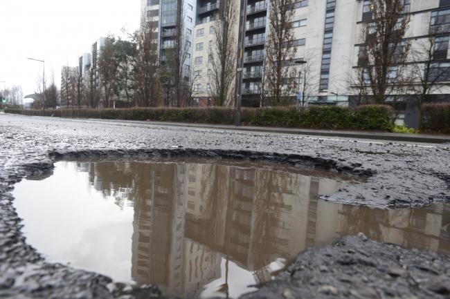 GLASGOW, SCOTLAND - FEBRUARY 11: a general view a pot hole on South Street in Partick outside Glasgow Harbour development on February 11, 2020 in Glasgow, Scotland. (Photo by Jamie Simpson/Herald & Times) - JS.