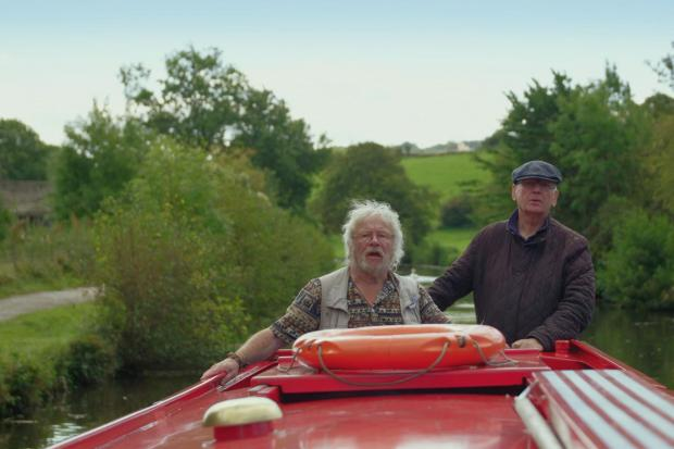 Bill and Pete driving at the end of boat.