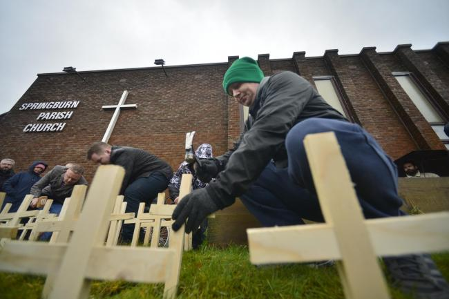 GLASGOW, SCOTLAND - FEBRUARY 14: drug death campaigners plant 200 wooden memorial crosses outside Springburn Parish Church to represent those that have died from drug related issues in Glasgow in the last two months on February 14, 2020 in Glasgow, Scotla
