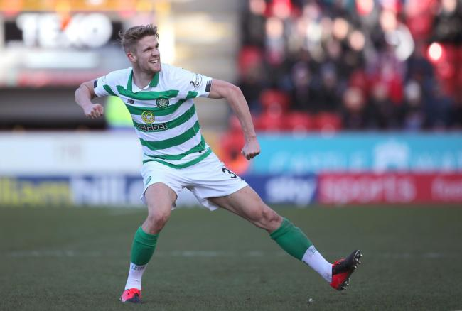 Kristoffer Ajer celebrates after his late goal gave Celtic another three points at Pittodrie.