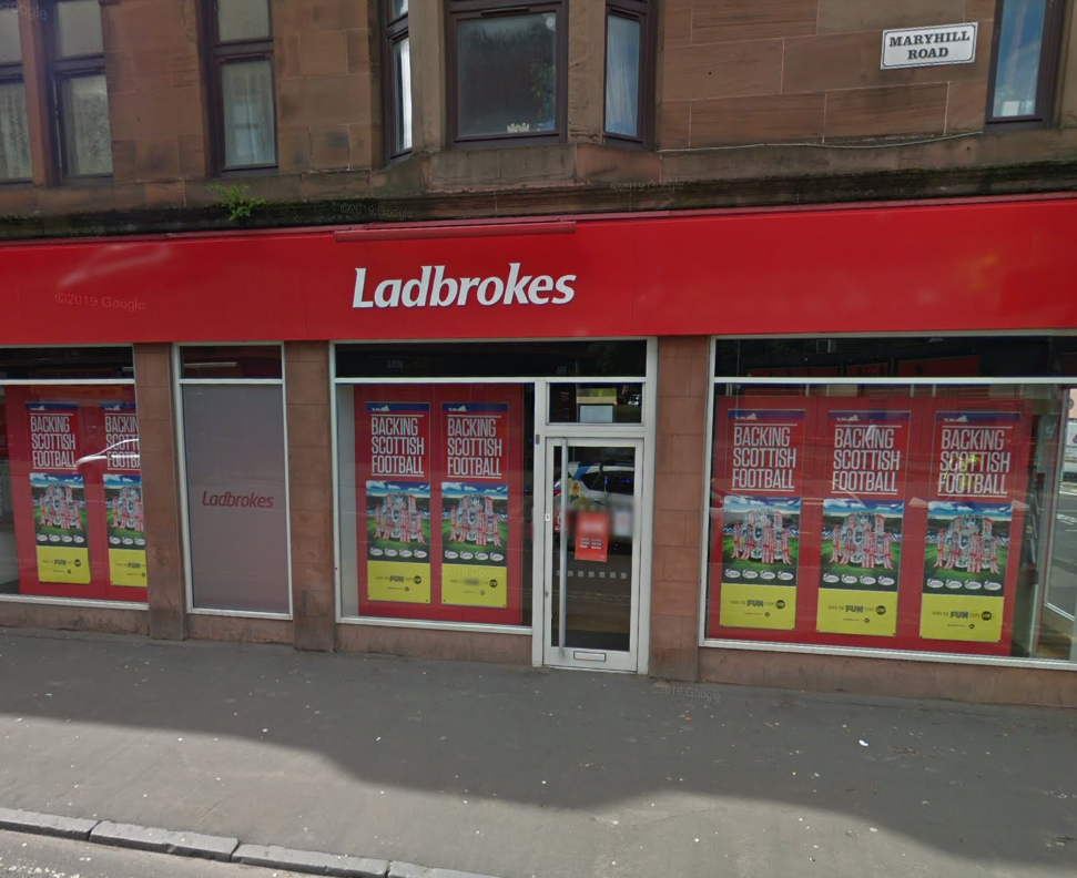High-vis thug armed with weapon steals cash from bookies in shock raid