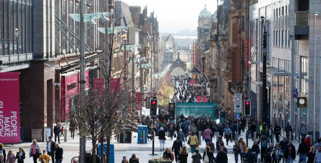 Woman arrested after man found injured in Buchanan Street flat