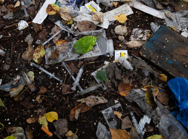 Picture of used drug paraphernalia (needles, spoons etc) lying abandoned by drug users in an area of land adjacent to London Road, Glasgow. ..Re. story about days of action by Police Scotland targeting vulnerable drug users and street dealing in Glasgow..