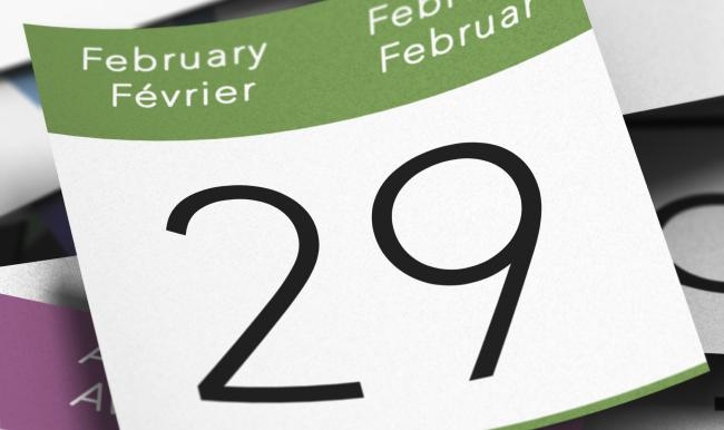 Calendar where it's written february 29th with a blue thumbtack, leap year day image.