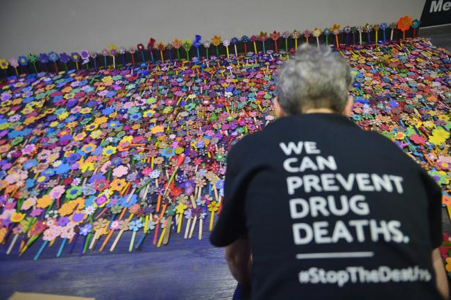 GLASGOW, SCOTLAND - FEBRUARY 26: paper flowers are laid to represent drug deaths at the Scottish Drug Deaths Crisis Conference at the SEC. Speakers include Scottish public health minister Joe FitzPatrick, Glasgow City Council leader Susan Aitken, senior m