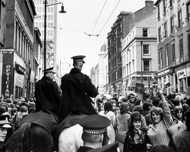 Mounted police in West Nile Street try to control the crowd of Beatles fans who have gathered for the concert at the Odeon cinema in Renfield Street in Glasgowin October 1964