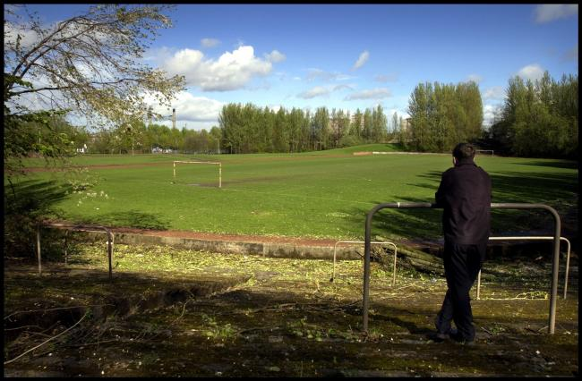 A fan looks out over Cathkin Park, home of Third Lanark Football Club.