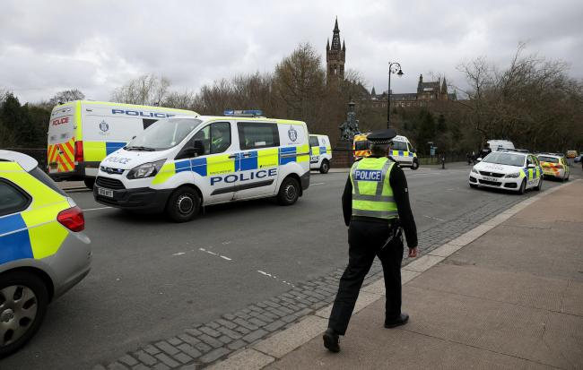 Police seen approaching the man standing in the River Kelvin then leading him to the banks