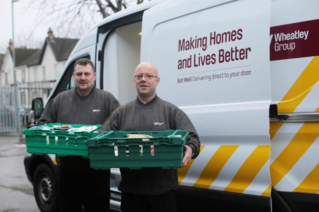 Kenny Church, of Move On, charity which helps young people and ex-homeless, and who work with us on Eat Well, and Wheatley enviro operative Richard Qua, prepare to make Eat Well delivery