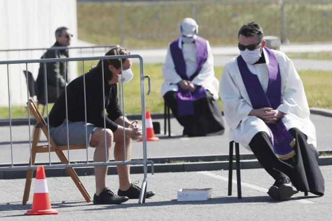 Priests take Good Friday confession in Warsaw, Poland