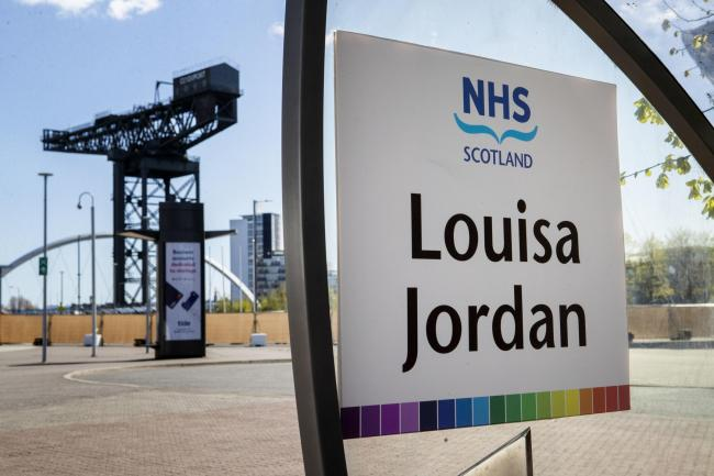 Signs outside the completed NHS Louisa Jordan hospital, built at the SEC Centre in Glasgow, to care for coronavirus patients. PA Photo. Picture date: Monday April 20, 2020. See PA story HEALTH Coronavirus. Photo credit should read: Jane Barlow/PA Wire