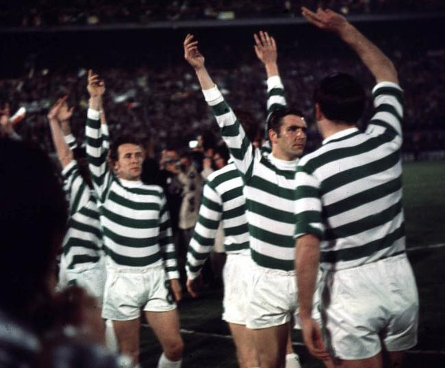 Celtic players wave to their travelling support before the start of the Feyenoord defeat in Milan