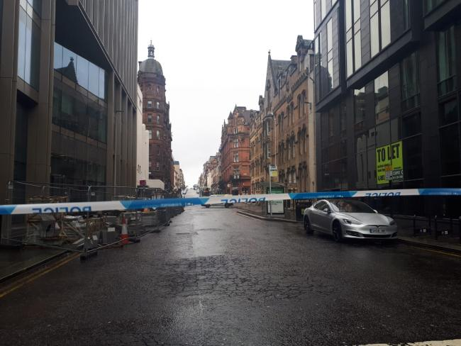 Falling debris prompts police to cordon off city centre street