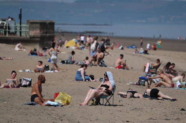 Glasgow Times: Sunbathers rushed to beaches to embrace the sunshine