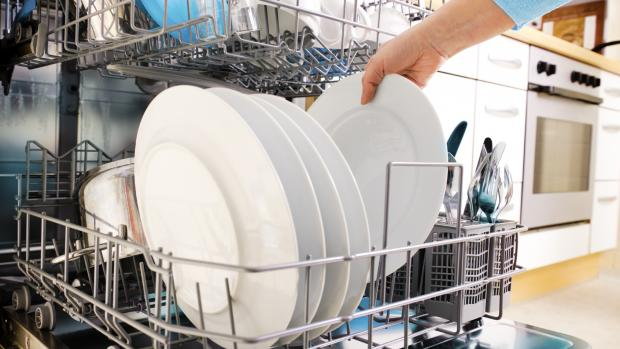 Glasgow Times: There's a method to the dishwasher organizing madness. Credit: Getty Images